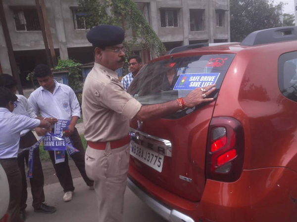 Pasting of Safe Drive Save Life Stickers On 24.08.2018 at Bhagat Singh More Asansol by the Student of Upendra Nath Boys High School Asansol, in presence of ACP Traffic - IV, Traffic Inspector Asansol, OC Asansol South Sub Traffic Guard.