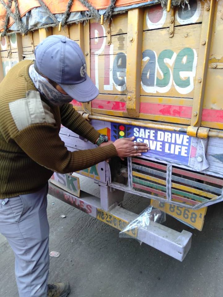 On 18.01.19 pasting of SDSL stickers on different types of vehicles on NH 2 as Road safety Month at Banali more checking point under Jamuria STG.